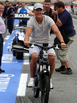 Michael Schumacher, Mercedes GP with his electric bike