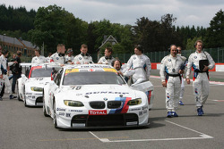 The crew pushes the BMW's to the grid