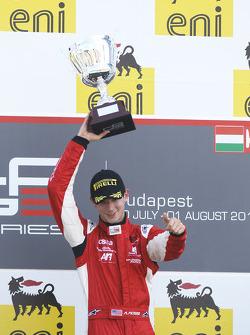 Alexander Rossi celebrates victory on the podium