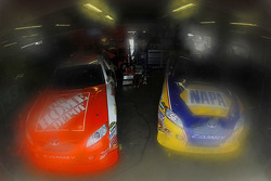 Cars of Joey Logano, Joe Gibbs Racing Toyota and Martin Truex Jr., Michael Waltrip Racing Toyota