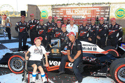 Race winner Will Power, Team Penske receives the inaugural 'Mario Andretti Road Championship Trophy' from Mario Andretti and Brian McEnnerney