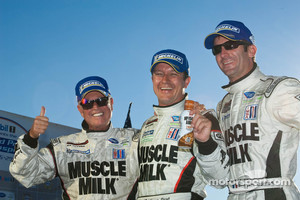 Greg Pickett with drivers Klaus Graf and Romain Dumas celebrate Mosport 2010 win