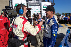 Race winner Scott Pruett gives TV interviews