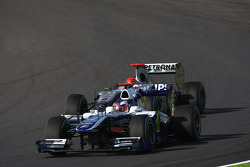 Rubens Barrichello, Williams F1 Team leads Michael Schumacher, Mercedes GP