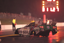 The body of Ashley Force Hood's Castrol GTX Mustang rests on the track after an explosion that separated the body from the chassis