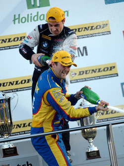 Andrew Jordan and Steven Kane spray champagne