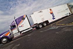 The FedEx hauler pulls into the track