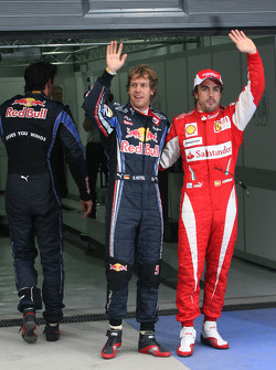Pole winner Sebastian Vettel, Red Bull Racing, third place Fernando Alonso, Scuderia Ferrari