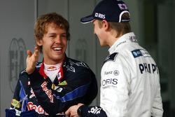 Pole winner Nico Hulkenberg, Williams F1 Team, with second place Sebastian Vettel, Red Bull Racing