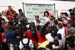 Jenson Button, McLaren Mercedes talks to the media after an attempted armed robbery on his car