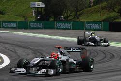 Michael Schumacher, Mercedes GP leads Nico Hulkenberg, Williams F1 Team