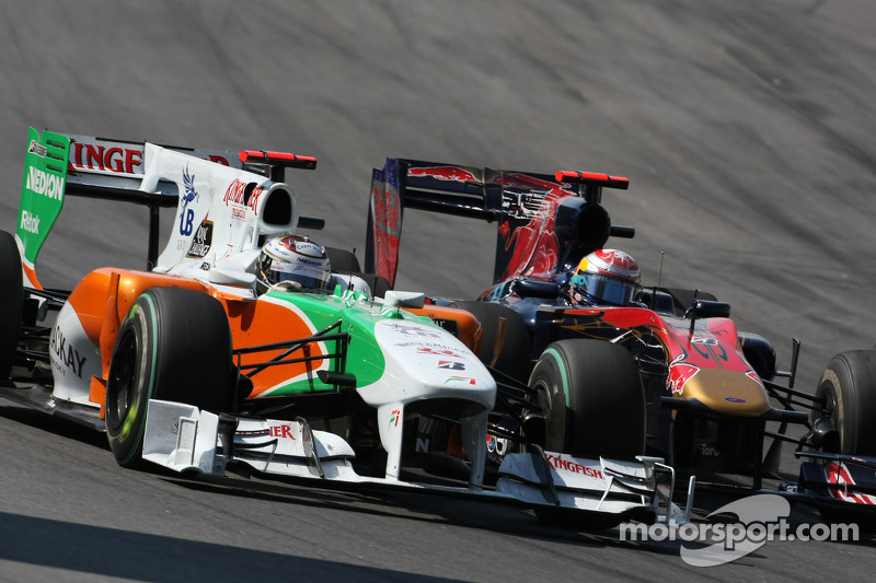 Adrian Sutil, Force India F1 Team et Sébastien Buemi, Scuderia Toro Rosso