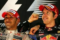 Podium: race winner and 2010 Formula One World Champion Sebastian Vettel, Red Bull Racing, second place Lewis Hamilton, McLaren Mercedes