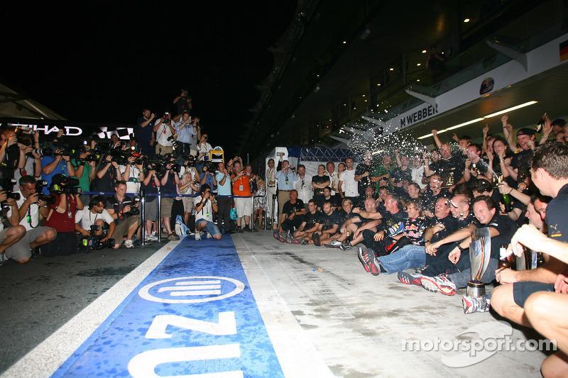 Race winner and 2010 Formula One World Champion Sebastian Vettel, Red Bull Racing, celebrates with h