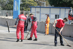Team Members are cleaning the Entrance of the Pitlane