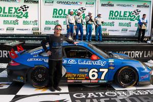 Team owner Kevin Buckler celebrates 2011 Daytona24 GT victory
