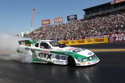 Mike Neff doing a burnout in his Castrol GTX Ford Mustang Funny Car