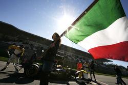 A grid girl with an Italian flag in front of Fairuz Fauzy