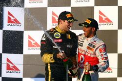 Podium: third place Vitaly Petrov, Lotus Renault GP and Lewis Hamilton, McLaren Mercedes