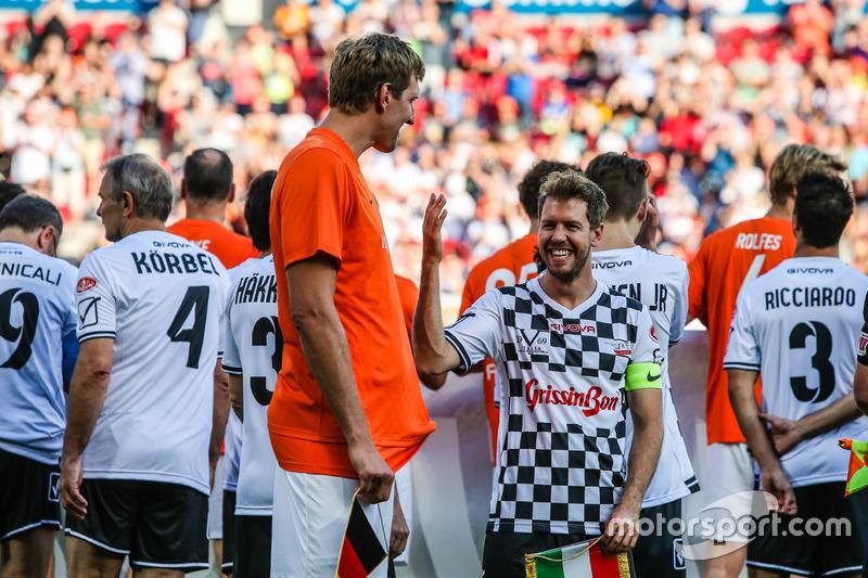 Dirk Nowitzki, jugador de la NBA y Sebastian Vettel, Ferrari