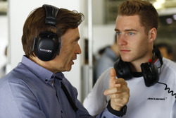 Stoffel Vandoorne, McLaren Test and Reserve driver talks to Jost Capito, McLaren chief executive