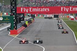 Sebastian Vettel, Ferrari SF16-H and Sergio Perez, Sahara Force India F1 VJM09 battle for position