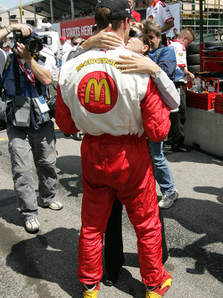 Pole winner Sébastien Bourdais celebrates with his girlfriend