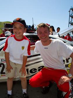 #20 Ferrari of Houston Ferrari 458 Challenge: Cooper MacNeil with a young fan