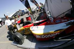 Newman Haas Racing crew members unload the cars