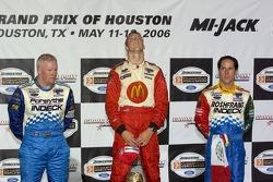 Podium: race winner Sébastien Bourdais with Paul Tracy and Mario Dominguez