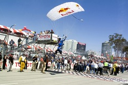 A Redbull parachutist flys over the grid