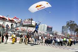 A Redbull parachutist flys over the grid
