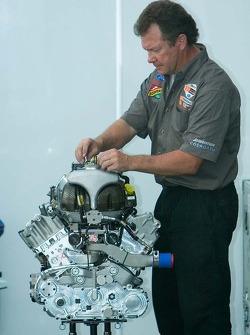 CTE Racing - HVM mechanic works on a Cosworth V8 engine