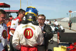 Carl Haas congratulates Sébastien Bourdais on winning the provisional pole
