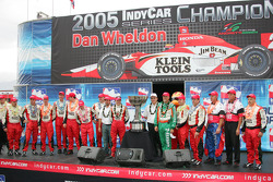 2005 IRL champion Dan Wheldon celebrates with his team