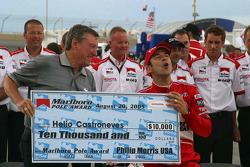Johnny Rutherford gives Helio Castroneves the pole check