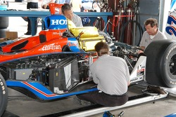 Crew works on Dario Franchitti car