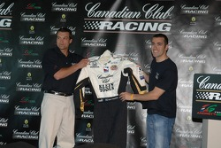 Dario Franchitti, right, shows off the Canadian Club-Klein Tools firesuit that he will wear starting at the 90th Indianapolis 500
