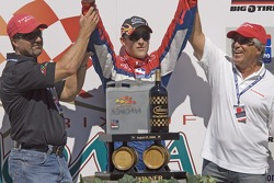 Victory lane: race winner Marco Andretti celebrates with father Michael and grandfather Mario