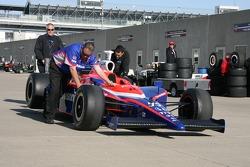 Super Aguri Panther Racing crew members push the car to pitlane