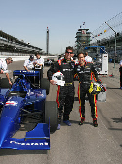 Vitor Meira, driver of the Panther Racing #4 Delphi Dallara Honda, poses with the passenger of his next two-seater ride