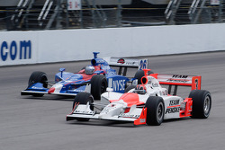 Marco Andretti goes around Helio Castroneves