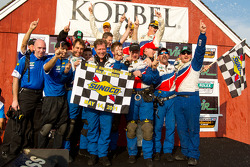 DP podium: class and overall winners Joao Barbosa, Terry Borcheller and JC France celebrate with Action Express Racing team members