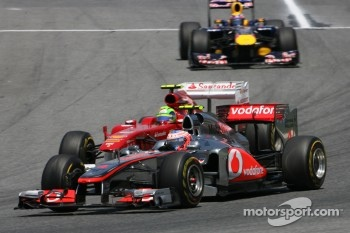 Jenson Button (McLaren) passing Felipe Massa (Ferrari)