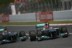 Nico Rosberg, Mercedes GP Petronas F1 Team and Michael Schumacher, Mercedes GP Petronas F1 Team