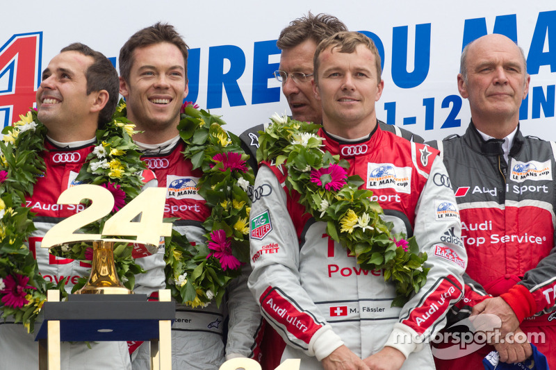 LM P1 podium: class and overall winners Marcel Fässler, André Lotterer and Benoit Tréluyer with Dr. Wolfgang Ullrich