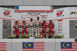 GT300 class podium: Winner Nobuteru Taniguchi and Taku Bamba, second place Tetsuya Tanaka and Katsuyuki Hiranaka, third place Yutaka Yamagishi and Hideki Yamauchi