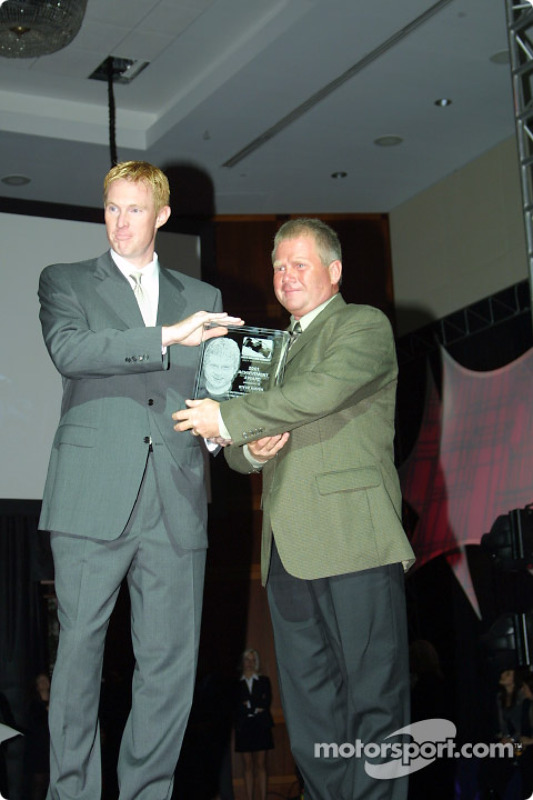 Indy Racing League Director of Operations John Lewis presented the Indy Racing League Achievement Award to Indy Racing League Transportation Coordinator, Steve Kiefer