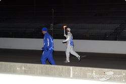 Tony George carries Olympic Torch toward Turn 1