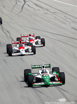 Tony Kanaan leads Helio Castroneves and Gil de Ferran